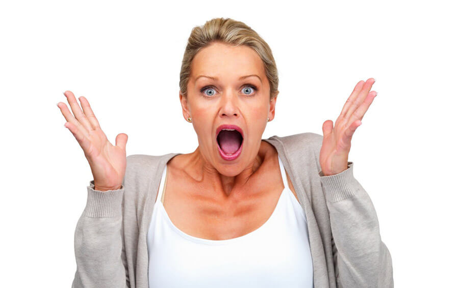 Surprised woman isolated against white background